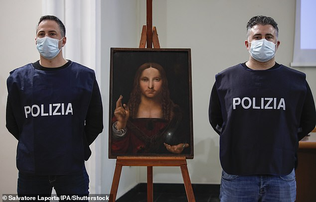 "Agents of the crime against heritage division of the Naples Flying Squad display ""Salvatore Mundi"", A painting from the Leonardo School dating back to the 15th century"