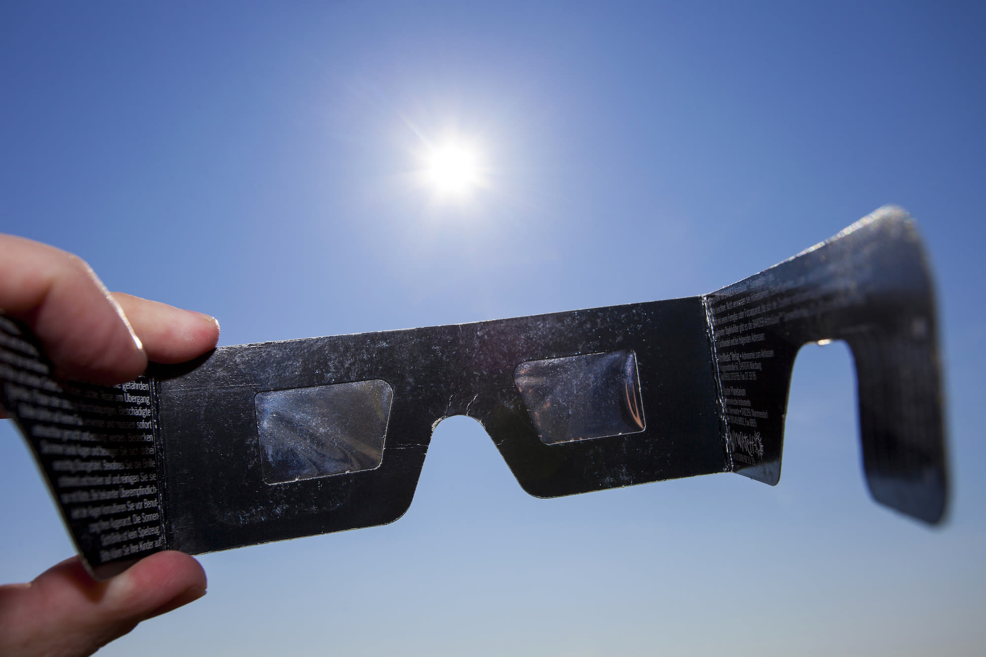 Eclipse glasses for protection from bright sunlight during a solar eclipse.  Photo: Adobe Stock / Bruno_A