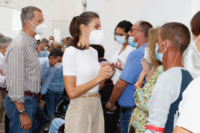 Spain's King Philip VI and Queen Letizia in conversation with evacuees.